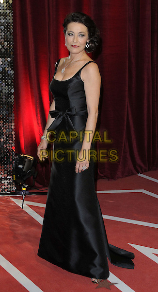 Amanda Donohoe.attended the British Soap Awards 2013, Media City, Salford, Manchester, England, UK, 18th May 2013..arrivals full length black  dress  bow long maxi side .CAP/CAN.©Can Nguyen/Capital Pictures.