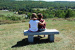 Two young friends enjoying the view on a summer day in New Hampshire USA