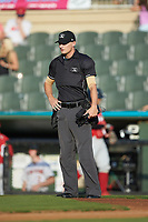 Home plate umpire Anthony Warner between innings of the South Atlantic League game between the Lakewood BlueClaws and the Kannapolis Intimidators at Kannapolis Intimidators Stadium on July 7, 2018 in Kannapolis, North Carolina. The Intimidators defeated the BlueClaws 4-3 in 10 innings.  (Brian Westerholt/Four Seam Images)