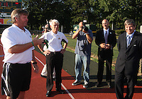Bill Andrulis coach of George Mason talks to Harold Mayne-Nicholls during the visit of the FIFA World Cup 2018-2022 inspection delegation to George Mason University soccer practice facility.