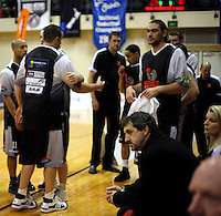 Hawks coaches Shawn Dennis (lower middle) and Kirstin Taylor (left) are pensivce before tip-off. NBL Semifinal - Wellington Saints v Bay Hawks at TSB Bank Arena, Wellington on Friday, 25 June 2010. Photo: Dave Lintott/lintottphoto.co.nz
