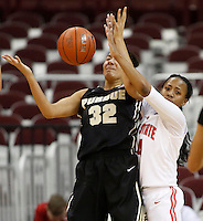 Ohio State Buckeyes guard Ameryst Alston (14) defends against Purdue Boilermakers forward Whitney Bays (32) in the second half of a women's basketball game between the Ohio State Buckeyes and the Purdue Boilermakers at Value City Arena on January 2, 2014. ( Dispatch photo by Fred Squillante)