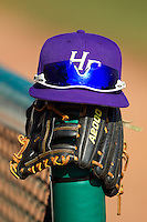 A High Point Panthers cap sits on top of a glove between innings of the game against the Bowling Green Falcons at Willard Stadium on March 9, 2014 in High Point, North Carolina.  The Falcons defeated the Panthers 7-4.  (Brian Westerholt/Four Seam Images)
