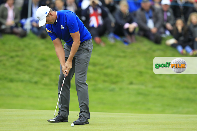 Henrik Stenson (EUR) putts on the 18th green during Sunday's Singles Matches of the Ryder Cup 2014 played on the PGA Centenary Course at the Gleneagles Hotel, Auchterarder, Scotland.: Picture Eoin Clarke, www.golffile.ie: 28th September 2014