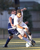 "University of Rhode Island (URI) defender Robby Gargaro (17) gets ""all ball"" against Boston College forward Charlie Rugg (17). Boston College defeated University of Rhode Island, 4-2, at Newton Campus Field, September 25, 2012."