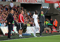 Pictured L-R: Swansea manager Garry Monk and assistant Kristian O'Leary get Eder ready for a substitution Sunday 30 August 2015<br /> Re: Premier League, Swansea v Manchester United at the Liberty Stadium, Swansea, UK