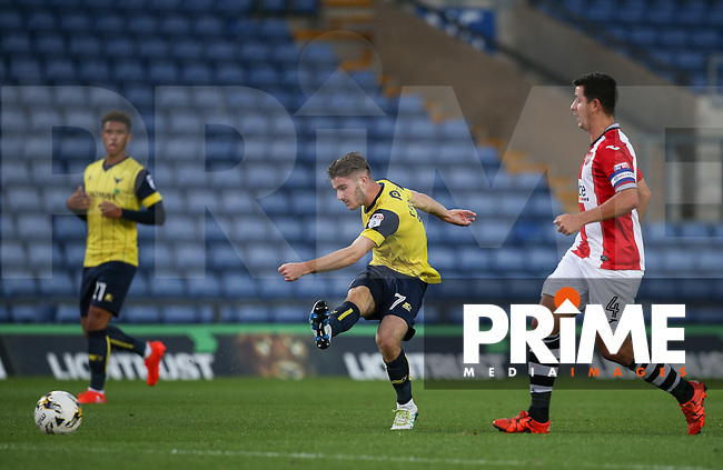Dan Crowley of Oxford United hits a shot at goal during the The Checkatrade Trophy match between Oxford United and Exeter City at the Kassam Stadium, Oxford, England on 30 August 2016. Photo by Andy Rowland / PRiME Media Images.