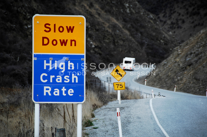 Road warning signs through windy road, Lindis Pass, South Island