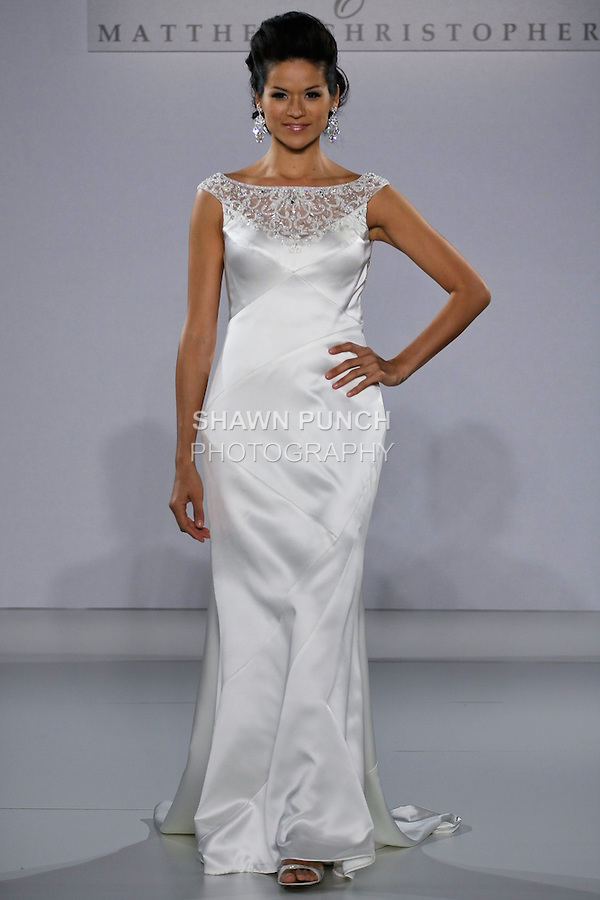 Model walks runway in a Gwendolyn wedding dress from the Matthew Christopher Couture Spring 2013 collection, at the Couture Show, during New York Bridal Fashion Week Spring 2013.