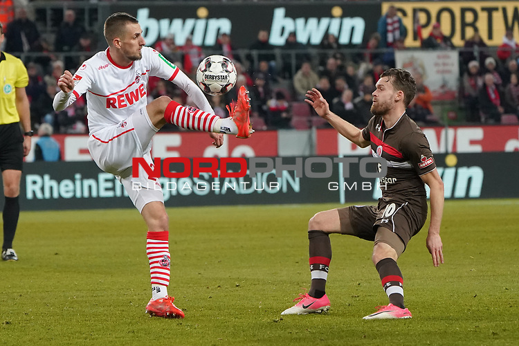 08.02.2019, RheinEnergieStadion, Koeln, GER, 2. FBL, 1.FC Koeln vs. FC St. Pauli,<br />  <br /> DFL regulations prohibit any use of photographs as image sequences and/or quasi-video<br /> <br /> im Bild / picture shows: <br /> Dominick Drexler (FC Koeln #24), im Zweikampf gegen  Christopher Buchtmann (St Pauli #10), <br /> <br /> Foto &copy; nordphoto / Meuter