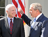 Washington, DC - March 5, 2008 -- United States President George W. Bush, right, points towards the Oval Office as he answers a reporter's question about his endorsement of United States Senator John McCain (Republican of Arizona), left, the presumptive 2008 Republican nominee for President of the United States in the Rose Garden of the White House on Wednesday, March 5, 2008..Credit: Ron Sachs / CNP