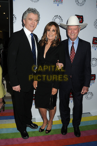 "Patrick Duffy, Linda Gray, Larry Hagman.""Television: Out Of The Box"" Museum Exhibit created by Warner Bros. Television Group held at The Paley Center, Beverly Hills, California, USA..April 12th, 2012.full length black suit dress white stetson hat.CAP/ADM/BP.©Byron Purvis/AdMedia/Capital Pictures."