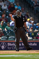 Home plate umpire Mark Hutchinson makes a strike call during the NCAA baseball game between the Oklahoma Sooners and the Missouri Tigers in game four of the 2020 Shriners Hospitals for Children College Classic at Minute Maid Park on February 29, 2020 in Houston, Texas. The Tigers defeated the Sooners 8-7. (Brian Westerholt/Four Seam Images)