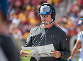 Indianapolis Colts head coach Frank Reich looks over his play sheet on the sidelines during the fourth quarter against the Washington Redskins at FedEx Field in Landover, Maryland on Sunday, September 16, 2018.  The Colts won the game 21 - 9.<br /> Credit: Ron Sachs / CNP