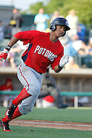 Potomac Nationals second baseman Christopher Bostick (11) running to first baseduring a game against the Myrtle Beach Pelicans at Ticketreturn.com Field at Pelicans Ballpark on May 22, 2015 in Myrtle Beach, South Carolina.  Myrtle Beach defeated Potomac 8-4. (Robert Gurganus/Four Seam Images)