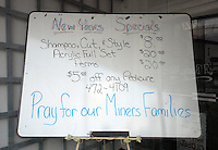 A prayer request for the 12 miners killed at the Sago mine explosion in Buckhannon, WV, is written Friday, Jan. 6, 2006,  on the New Years Specials board at a hair salon in Buckhannon. (Photo by Gary Gardiner)....<br />