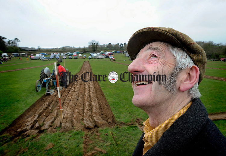 Gort's John Quinn gives alook skyward as the rain holds off at the Clare Ploughing Association's county championships at Newmarket On Fergus. Photograph by John Kelly.