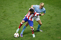 Atletico de Madrid´s Arda Turan (L)and Malmo´s Helander during Champions League soccer match between Atletico de Madrid and Malmo at Vicente Calderon stadium in Madrid, Spain. October 22, 2014. (ALTERPHOTOS/Victor Blanco)