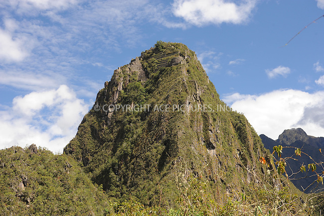 "WWW.ACEPIXS.COM . . . . . .January 9, 2013...Peru...Huayna Picchu also known as Wayna Picchu (Quechua: ""Young Peak"") is a mountain in Peru around which the Urubamba River bends. It rises over Machu Picchu, the so-called lost city of the Incas, and divides it into sections. The Incas built a trail up the side of the Huayna Picchu and built temples and terraces on its top. The peak of Huayna Picchu is about 2,720 metres (8,920 ft) above sea level, or about 360 metres (1,180 ft) higher than Machu Picchu... January 9, 2013 in Peru ....Please byline: KRISTIN CALLAHAN - ACEPIXS.COM.. . . . . . ..Ace Pictures, Inc: ..tel: (212) 243 8787 or 212 489 0521..e-mail: kristincallahan@aol.com...web: http://www.acepixs.com ."