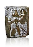 Hittite orthostat relief depicting a god. Hittie Period 1450 - 1200 BC. Hattusa Boğazkale. Hattusa Boğazkale. Çorum Archaeological Museum, Corum, Turkey. Çorum Archaeological Museum, Corum, Turkey. Against a white bacground.