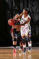 25 November 2011:  FIU guard Jerica Coley (22) passes the ball while being defended by Maryland guard Anjale Barrett (10) in the first half as the University of Maryland Terrapins defeated the FIU Golden Panthers, 84-52, at the U.S. Century Bank Arena in Miami, Florida.