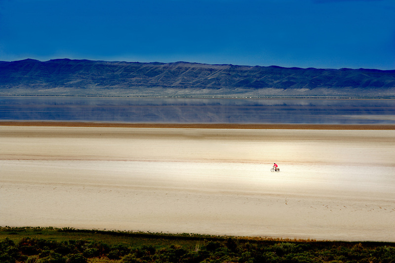 Lone bike rider on Alvord Desert. Oregon