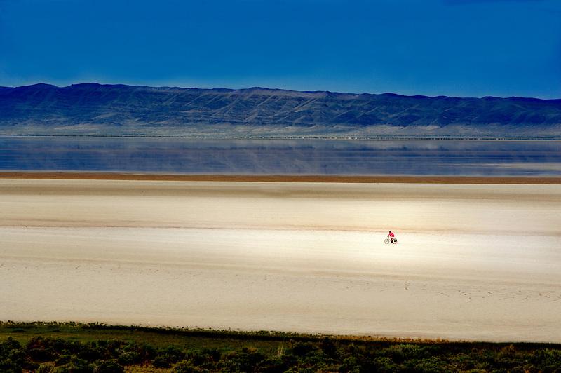 Lone bike rider on Alvord Desert. Oregon