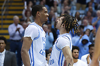 CHAPEL HILL, NC - FEBRUARY 25: Garrison Brooks #15 of the University of North Carolina celebrates with Cole Anthony #2 after a breakaway dunk by Anthony during a game between NC State and North Carolina at Dean E. Smith Center on February 25, 2020 in Chapel Hill, North Carolina.