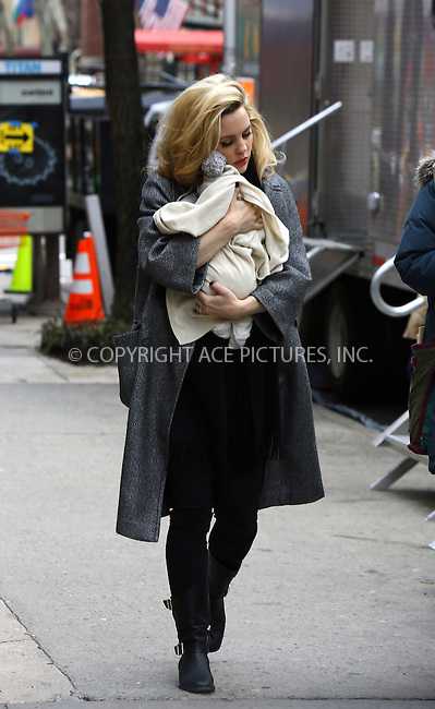 WWW.ACEPIXS.COM<br /> <br /> March 20 2014, New York City<br /> <br /> Actress Melissa George carries her new baby Rapha&euml;l Blanc on the set of the Untitled Richard LaGravenese Project on March 20 2014 in New York City<br /> <br /> <br /> By Line: Philip Vaughan/ACE Pictures<br /> <br /> ACE Pictures, Inc.<br /> tel: 646 769 0430<br /> Email: info@acepixs.com<br /> www.acepixs.com