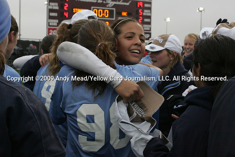 06 December 2009: North Carolina's Casey Nogueira and Tobin Heath (98) embrace during the postgame celebration. The University of North Carolina Tar Heels defeated the Stanford University Cardinal 1-0 at Aggie Soccer Stadium in College Station, Texas in the NCAA Division I Women's College Cup Championship game.