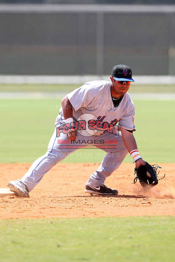 New York Mets minor league second baseman J.B. Brown #99 in the field during a spring training game vs the St. Louis Cardinals at the Roger Dean Complex in Jupiter, Florida;  March 24, 2011.  Photo By Mike Janes/Four Seam Images