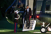 United States President Barack Obama salutes the Marine Guard as he steps off Marine One on the South Lawn of the White House in Washington, DC, USA, 09 October 2016. President Obama is returning from a weekend in Chicago.<br /> Credit: Shawn Thew / Pool via CNP