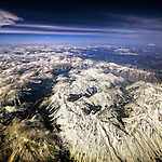 Aerial view flying over the snow capped Rocky Mountains of Colorado