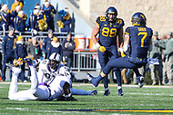 Morgantown, WV - November 10, 2018: West Virginia Mountaineers quarterback Will Grier (7) gets tackled by a TCU Horned Frogs defender during the game between TCU and WVU at  Mountaineer Field at Milan Puskar Stadium in Morgantown, WV.  (Photo by Elliott Brown/Media Images International)