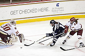Molly Schaus (BC - 30), Sarah Cuthbert (UNH - 14), Dru Burns (BC - 7) - The Boston College Eagles and the visiting University of New Hampshire Wildcats played to a scoreless tie in BC's senior game on Saturday, February 19, 2011, at Conte Forum in Chestnut Hill, Massachusetts.