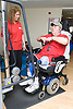 Man with prosthetic limb using pulley machine at a gym,