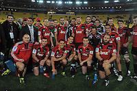 The Crusaders pose for a team photo with the trophy. Super 15 rugby match - Crusaders v Hurricanes at Westpac Stadium, Wellington, New Zealand on Saturday, 18 June 2011. Photo: Dave Lintott / lintottphoto.co.nz