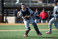 Richmond Spiders catcher Kyle Schmidt (37) looks to make a throw to first base against the Wake Forest Demon Deacons at David F. Couch Ballpark on March 6, 2016 in Winston-Salem, North Carolina.  The Demon Deacons defeated the Spiders 17-4.  (Brian Westerholt/Four Seam Images)