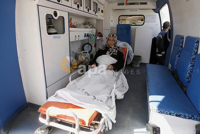 A Patient lies in an ambulance at the Rafah border crossing in the southern Gaza Strip on November 6, 2014. Egypt closed the crossing into the Gaza Strip, the only route into the Palestinian territory not controlled by Israel, after Egyptian president Abdel Fattah al-Sisi declared a state of emergency on October 25, 2014, for three months, after the death of 30 soldiers in a suicide attack. Photo by Abed Rahim Khatib