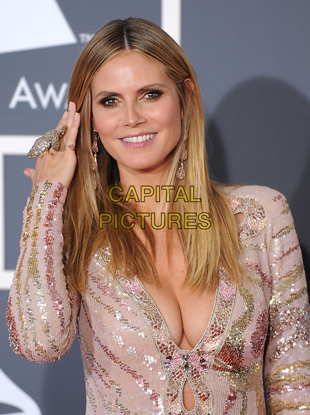 HEIDI KLUM.Arrivals at the 52nd Annual GRAMMY Awards held at The Staples Center in Los Angeles, California, USA..January 31st, 2010.grammys half length pink white sequins sequined dress plunging low cut neckline cleavage hand butterfly ring.CAP/RKE/DVS.©DVS/RockinExposures/Capital Pictures