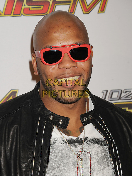 Flo Rida (Tramar Dillard).The 102.7 KIIS FM's Jingle Ball at the Nokia Theatre L.A. Live in Los Angeles, California, USA..December 3rd, 2011.headshot portrait stubble beard facial hair red leather black sunglasses shades .CAP/ROT/TM.©Tony Michaels/Roth Stock/Capital Pictures