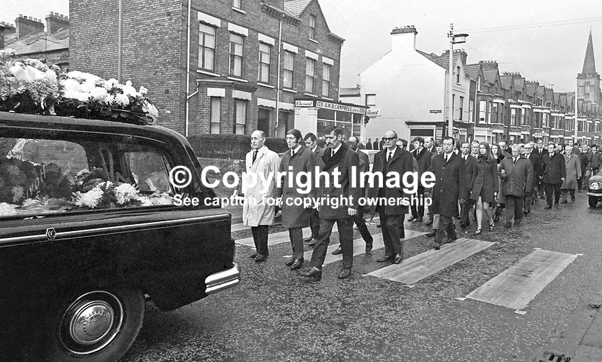 Funeral of 17 months old Colin Nicholl, the adopted son of Anne and &amp; Jackie Nicholl of Elimgrove Street, Belfast, N Ireland, UK. Colin was one of two children who died in a no warning Provisional IRA attack at a Shankill Road furniture store on 11th December 1971.. The other child was 2 year old Tracey Munn, also from the Shankill district. The two funerals joined up in Clifton Park Avenue on the way to the cemetery. 197112140533c<br /> <br /> Copyright Image from Victor Patterson, 54 Dorchester Park, Belfast, UK, BT9 6RJ<br /> <br /> t1: +44 28 9066 1296 (from Rep of Ireland 048 9066 1296)<br /> t2: +44 28 9002 2446 (from Rep of Ireland 048 9002 2446)<br /> m: +44 7802 353836<br /> <br /> e1: victorpatterson@me.com<br /> e2: victorpatterson@gmail.com<br /> <br /> The use of my copyright images is subject to my Terms &amp; Conditions.<br /> <br /> It is IMPORTANT that you familiarise yourself with them. They are available on my website at www.victorpatterson.com.<br /> <br /> None of my copyright images may be used on a website unless they are visibly watermarked, i.e. &copy; Victor Patterson within the body of the visible image. Metadata denoting my copyright must NOT be deleted. <br /> <br /> Web use is extra at currently recommended NUJ rates.