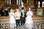 Scoil an Ghleanna pupils Caoimhe Nic Gearailt, Mikey O? Dubhain, Tadhg O? Cinne?ide and Eimer Ni? Ghrainne, with their muinteoir Deirdre Ni? Chinne?ide, the day of their First Communion at St. Mary's Church, Dingle, on Sunday.