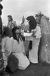 "Avebury Wiltshire, Druid blessings event. 1996. Emma Restall Orr high priestess of the British Druid Order  she offers a blessing to the ""inner child"" of bardic singer and songwriter Steve Andrews."