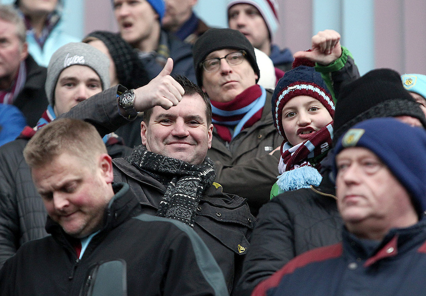 Burnley fans enjoy themselves during the half time break<br /> <br /> Photographer Rich Linley/CameraSport<br /> <br /> Football - Barclays Premiership - Burnley v Swansea City - Friday 27th February 2015 - Turf Moor - Burnley<br /> <br /> &copy; CameraSport - 43 Linden Ave. Countesthorpe. Leicester. England. LE8 5PG - Tel: +44 (0) 116 277 4147 - admin@camerasport.com - www.camerasport.com