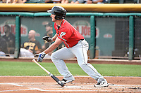 Jake Goebbert (11) of the El Paso Chihuahuas at bat against the Salt Lake Bees in Pacific Coast League action at Smith's Ballpark on August 7, 2014 in Salt Lake City, Utah.  (Stephen Smith/Four Seam Images)