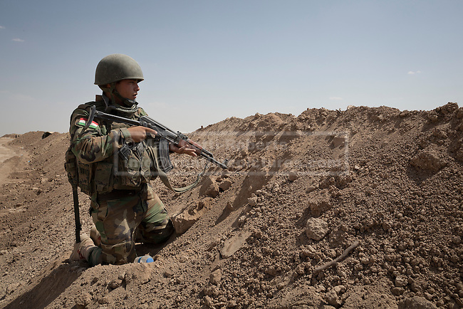 A soldier from the Kurdish Zerevani peshmerga keeps watch near Hamdaniya in Iraq. Despite their best efforts to defend the town, it was eventually lost to Islamic State forces.