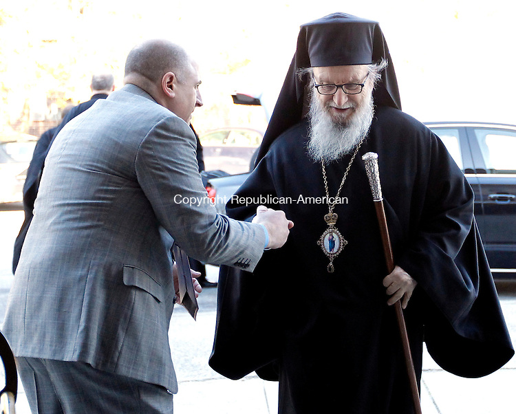 Waterbury, CT-26 February 2012-022612CM01-  Nick Gagas (left) of Middlebury shows his respects as he greets His Eminence Archbishop Demetrios of the Greek Orthodox Archdiocese of America before the start of the morning service at the Holy Trinity Greek Orthodox Church Sunday morning in Waterbury.  Archbishop Demetrios was greeted with a warm welcome by members of the church and was part of the Sunday services including the Matins followed by 10 o'clock Divine Liturgy.   Christopher Massa Republican-American