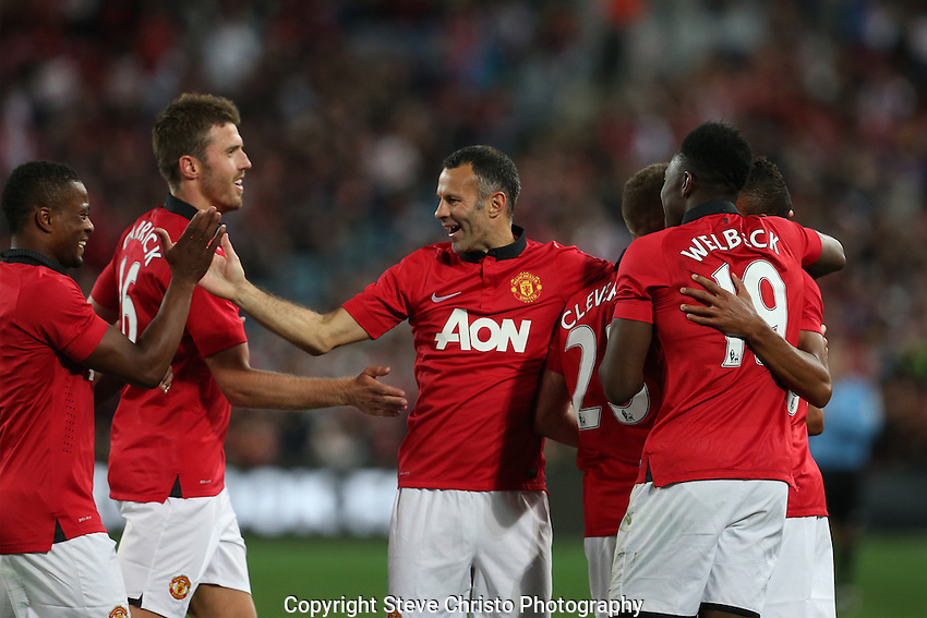 Manchester United's Jesse Lingard scores and celebrates his second goal  with teammates Tom Cleverley, Danny Welbeck, Ryan Giggs Michael Carrick and Patrice Evra against A-League All Stars at Stadium Australia, Sydney, Australia. Saturday, 20th July, 2013. (Photo: Steve Christo)