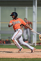 Outfielder Gregory Lorenzo (36) of the Baltimore Orioles organization during a minor league spring training camp day game on March 23, 2014 at Buck O'Neil Complex in Sarasota, Florida.  (Mike Janes/Four Seam Images)